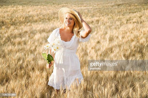 blonde beauty in wheat field - mid length hair stock pictures, royalty-free photos & images