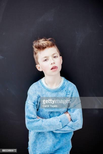 blonde boy in  black background.Simple portrait