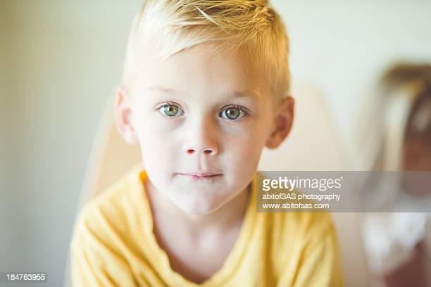Blonde boy in yellow shirt