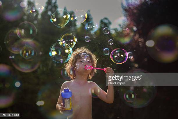 blonde boy play bubbles