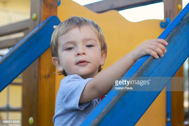 Blonde boy playing in a park