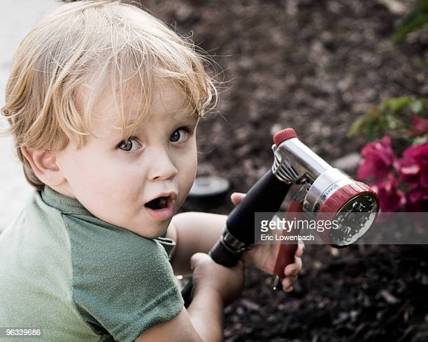blonde boy playing with sprinkler hose - trigger stock pictures, royalty-free photos & images