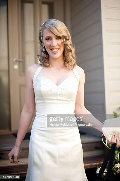 Blonde Bride walking down stairs