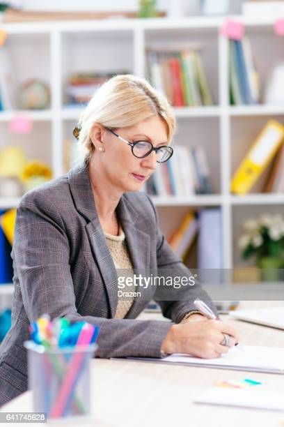 Blonde businesswoman working in office