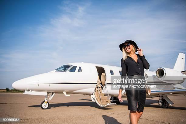 Blonde elegant woman leaving airport track