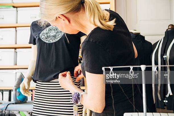 blonde Fashion designer at work