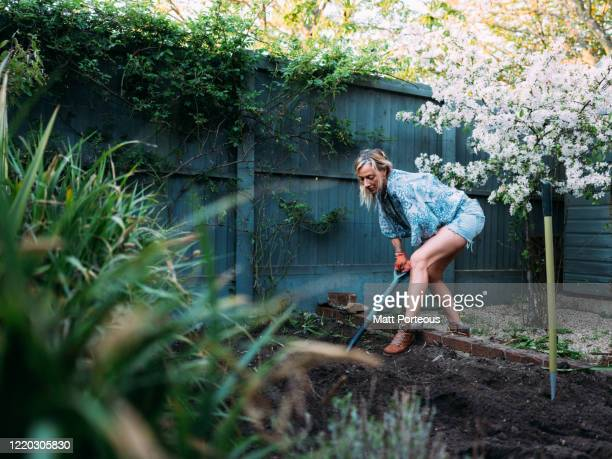 blonde female gardening - garden stock pictures, royalty-free photos & images