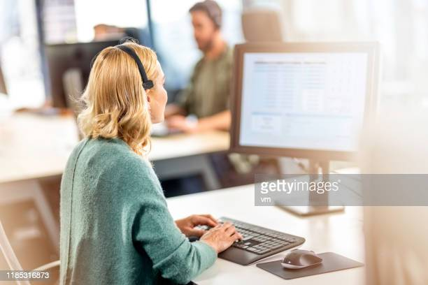 blonde female pollster using a computer and wearing a headset - unrecognisable person stock pictures, royalty-free photos & images