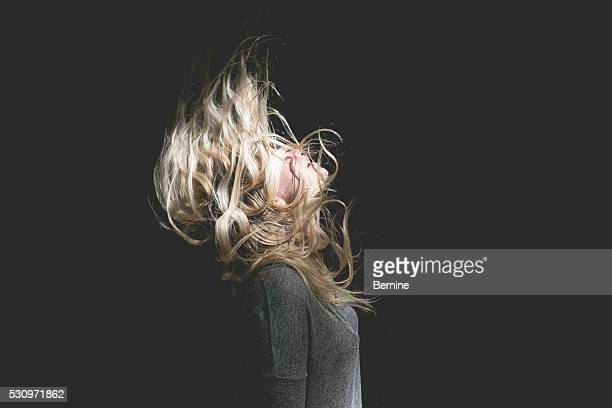 blonde female with hair over face - defiance stock pictures, royalty-free photos & images