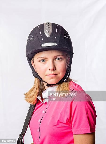 Blonde Fourteen year old female horse rider