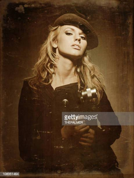 blonde girl film director - vintage raincoat stock pictures, royalty-free photos & images