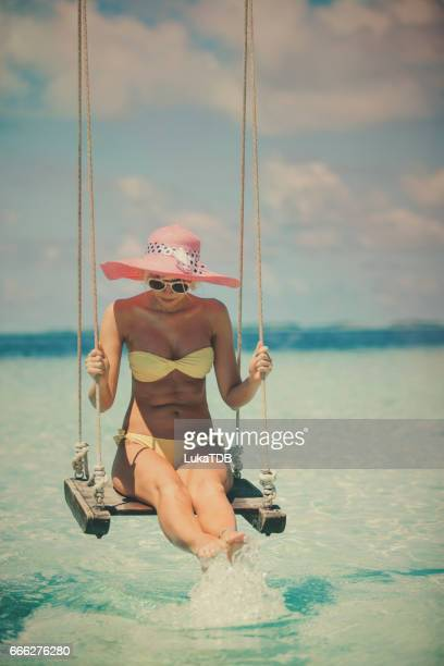 Blonde girl on the swing, Maldives