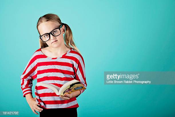 blonde girl reading book - girl nerd hairstyles stock photos and pictures