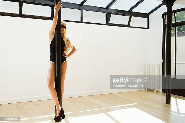 Blonde girl ready to pole dance