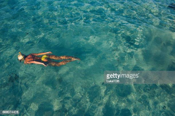 Blonde girl snorkeling on Maldives
