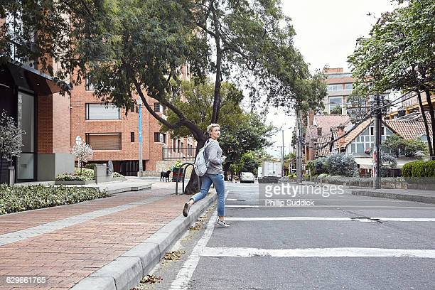 blonde girl taking with film camera in a city - pedestrian walkway stock pictures, royalty-free photos & images