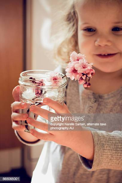Blonde girl with blossoms in jar