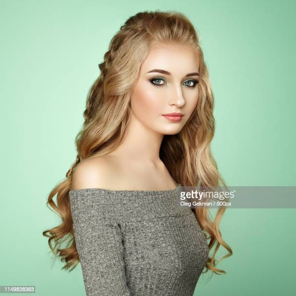 blonde girl with long and shiny curly hair - stratum corneum stock pictures, royalty-free photos & images
