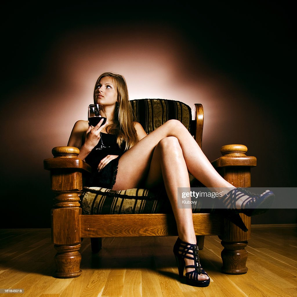 Blonde in an armchair : Stock Photo