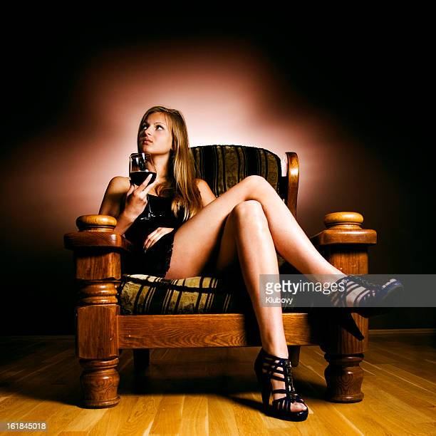 blonde in an armchair - beautiful long legs stock pictures, royalty-free photos & images
