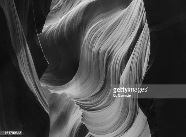 blonde in lower antelope canyon - ロウワーアンテロープ ストックフォトと画像