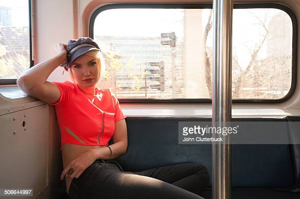 Blonde in red top and engineers cap on a train