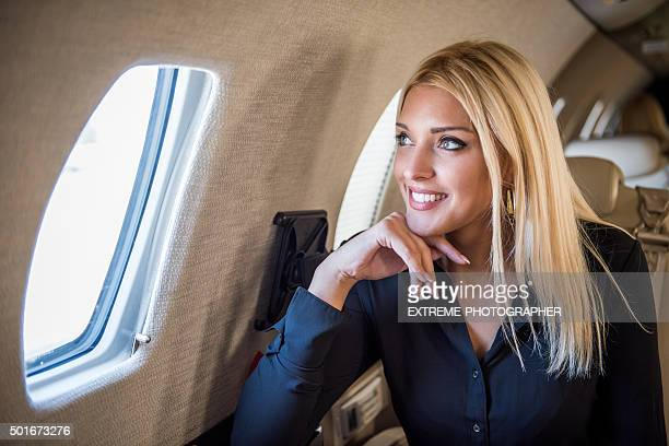 Blonde lady looking through the aeroplane window