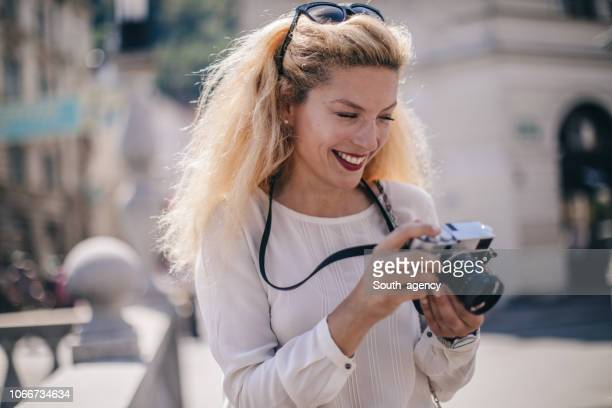 blonde lady tourist - ljubljana stock pictures, royalty-free photos & images