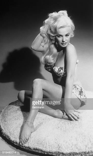 Blonde Mamie Van Doren, the 27 year old, was up in arms about rumors that she was dating a 17 year old college boy. Actually the handsome youngster...
