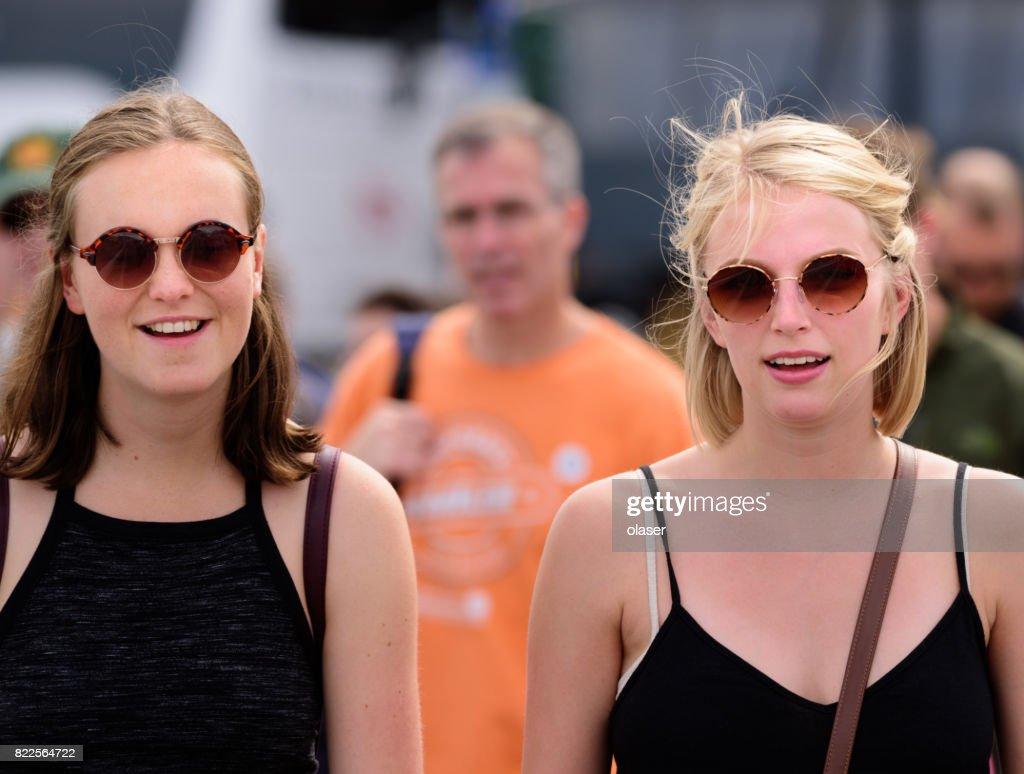 Blonde pedestrian women on zebra crossing : Stock Photo