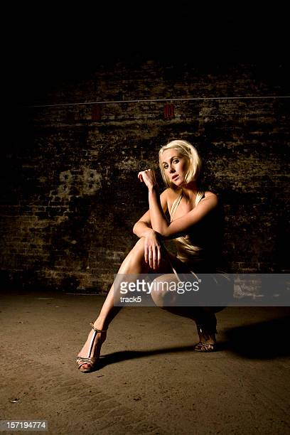 blonde - legs and short skirt sitting down stock pictures, royalty-free photos & images