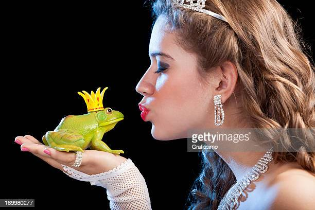 blonde princess kissing a frog prince - princess stock pictures, royalty-free photos & images