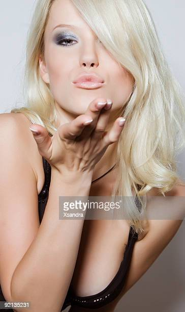 Blonde sending air kiss