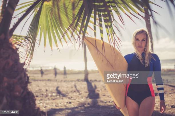 Blonde surfer woman at the beach