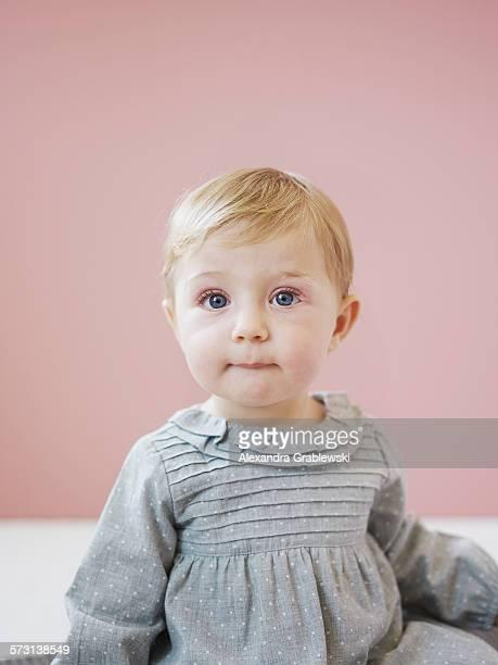 Blonde Toddler Girl Biting Lip