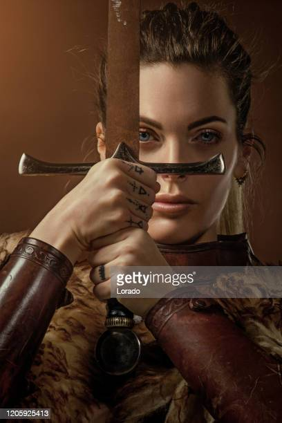 blonde viking warrior female in studio shot - princess stock pictures, royalty-free photos & images