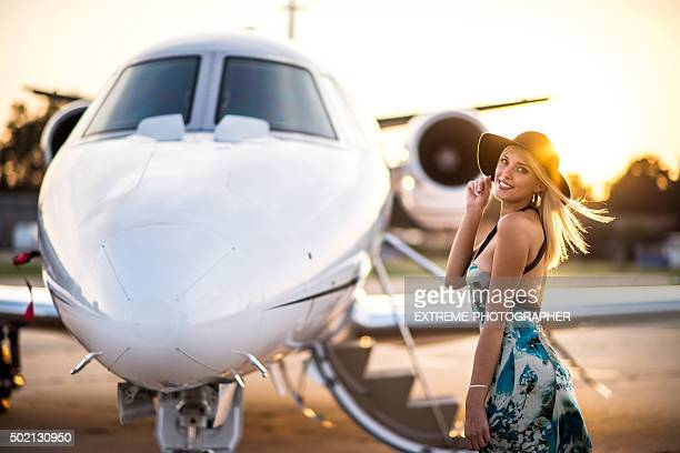 Blonde woman and private jet aeroplane