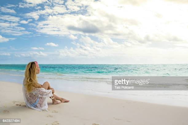 blonde woman enjoying a caribbean beach in mexico's mayan riviera, quintana roo, mexico - bikini bottom stock pictures, royalty-free photos & images