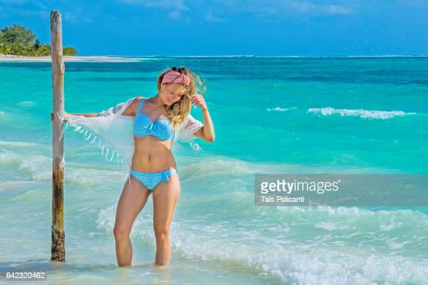 blonde woman enjoying a caribbean beach in mexico's riviera maya, quintana roo, mexico - bikini bottom stock pictures, royalty-free photos & images