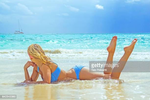 blonde woman enjoying a white sand caribbean beach in punta maroma, mexico's mayan riviera, quintana roo, mexico - bikini bottom stock pictures, royalty-free photos & images