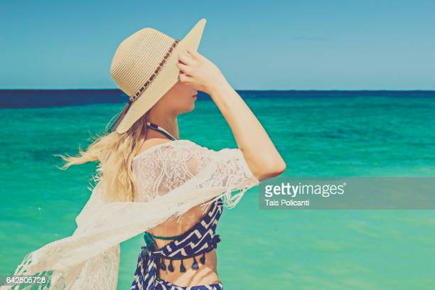 Blonde Woman enjoying a white sand caribbean beach in Punta Maroma, Mexico's Mayan Riviera, Quintana Roo, Mexico