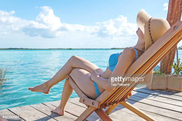 blonde woman enjoying the caribbean in the lagoon of bacalar, quintana roo, mexico's mayan riviera, mexico - bikini bottom stock pictures, royalty-free photos & images