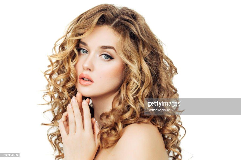 Blonde woman fashion model posing against black background : Stock Photo