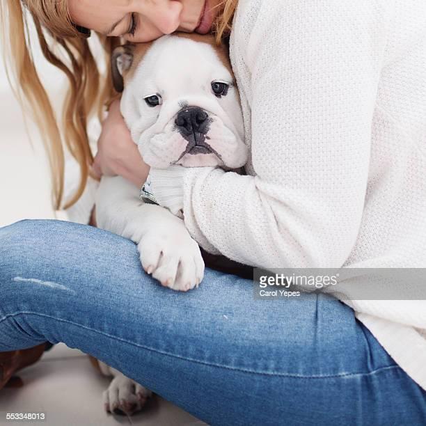 Blonde woman hugging bulldog