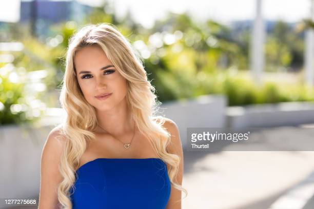 blonde woman in blue formal dress - strapless evening gown stock pictures, royalty-free photos & images