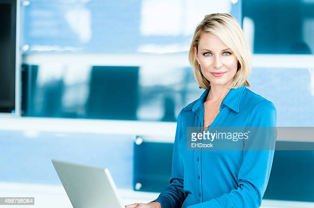 Blonde Woman in Modern Home Office
