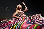 Blonde woman in wild patterned dress
