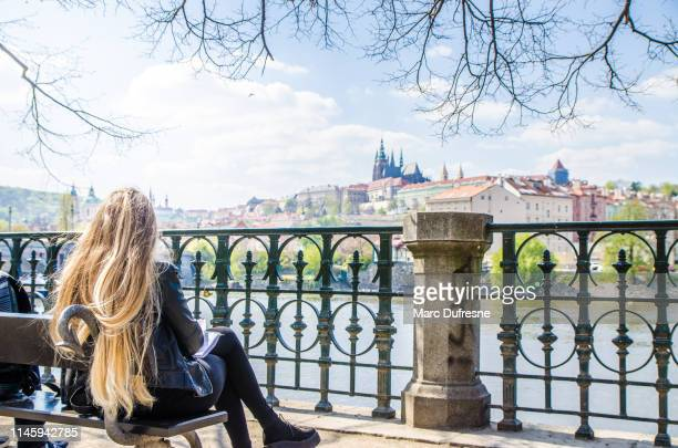 blonde woman looking at of vltava river - vltava river stock pictures, royalty-free photos & images