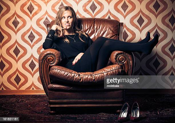 Blonde Woman Relaxing on Vintage Armchair