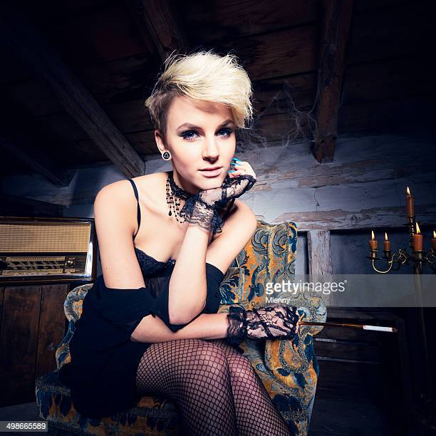 blonde woman retro vintage portrait - legs and short skirt sitting down stock pictures, royalty-free photos & images